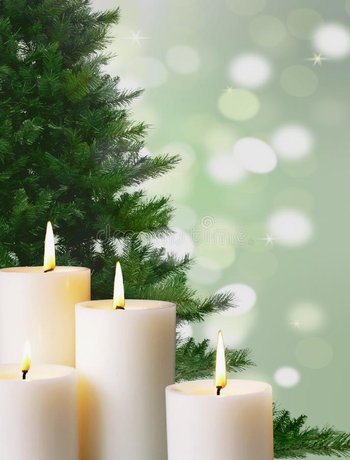 Candle light and christmas tree stock images