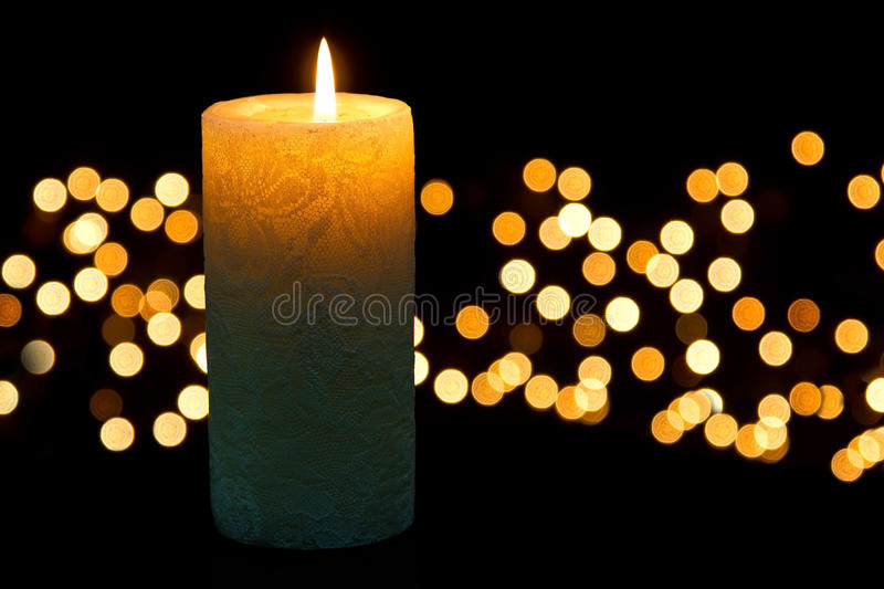 Candle light closeup with bokeh. Pattern and dark background royalty free stock photography