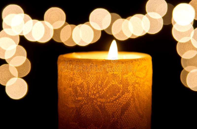 Candle light closeup with bokeh. Pattern and dark background royalty free stock photo