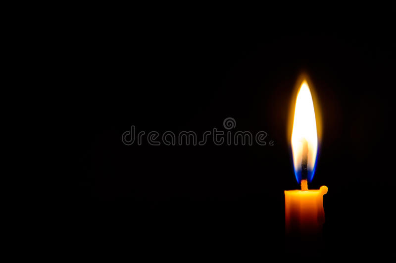 Candle light in the dark stock photo