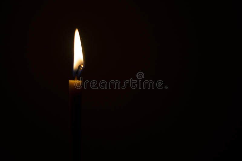 Candle light in the dark stock photography