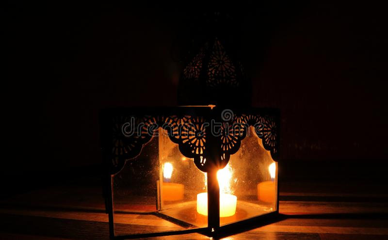 Candle light in the darkness and candle holder. Long exposure candle light royalty free stock photos