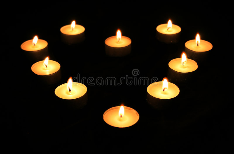 Candle light heart stock photography