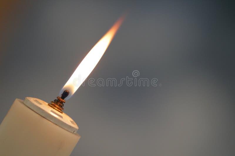 Candle lit during a Catholic mass stock photos