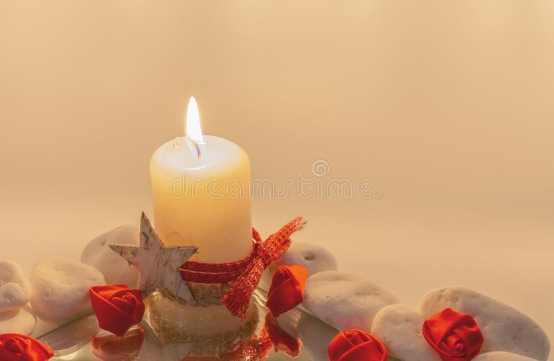 Litle roses in a candle light royalty free stock photography