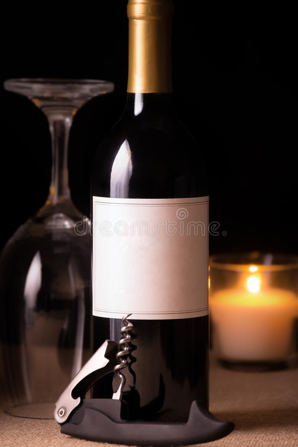 Red wine by candle light royalty free stock images