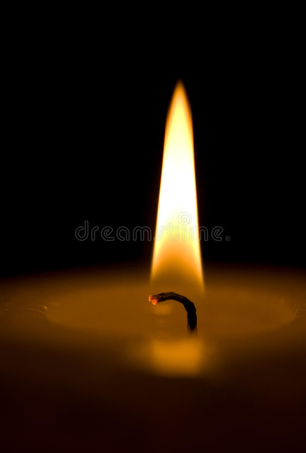Candle. Makro. A single candle on a black background. Makro royalty free stock images