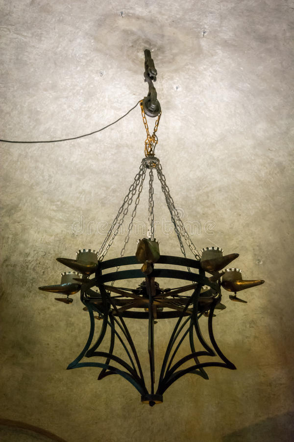 8 candle medieval chandelier hanged by chains over a pulley stock download 8 candle medieval chandelier hanged by chains over a pulley stock image image of aloadofball Images