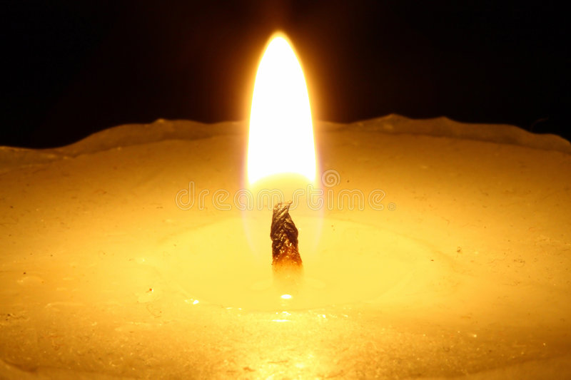 Candle in the night. royalty free stock image