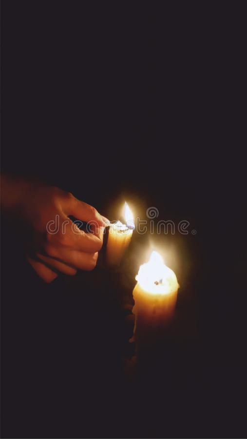 Candle in the night dark. Candles in night darkness, moment of silence royalty free stock image