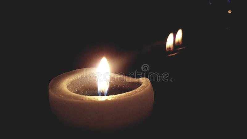 Candle in the dark, by window royalty free stock images