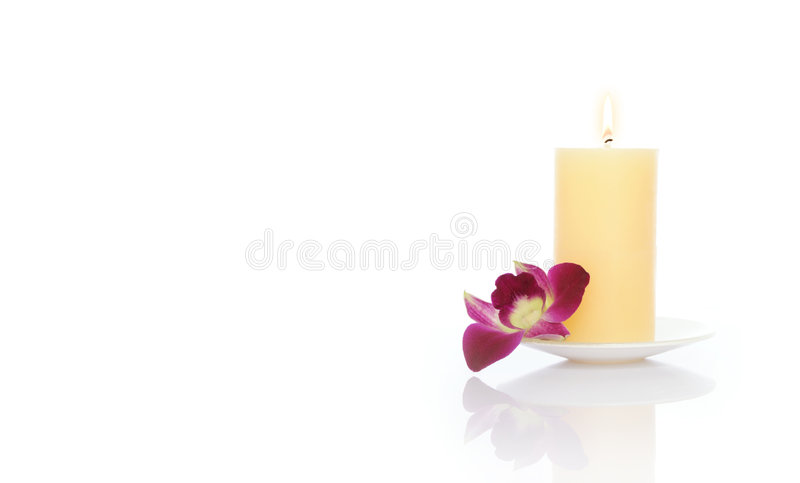 Candle and Orchid stock photography