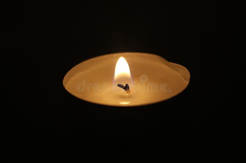 Candle picture on a night background burning and beautiful suitable for different purposes in my house. This photo  Candle picture on a night background burning stock images