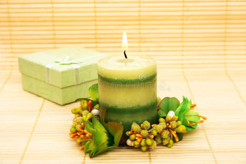 Candle and present box royalty free stock photo