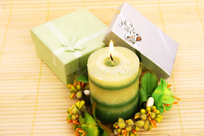 Candle and present boxes royalty free stock images