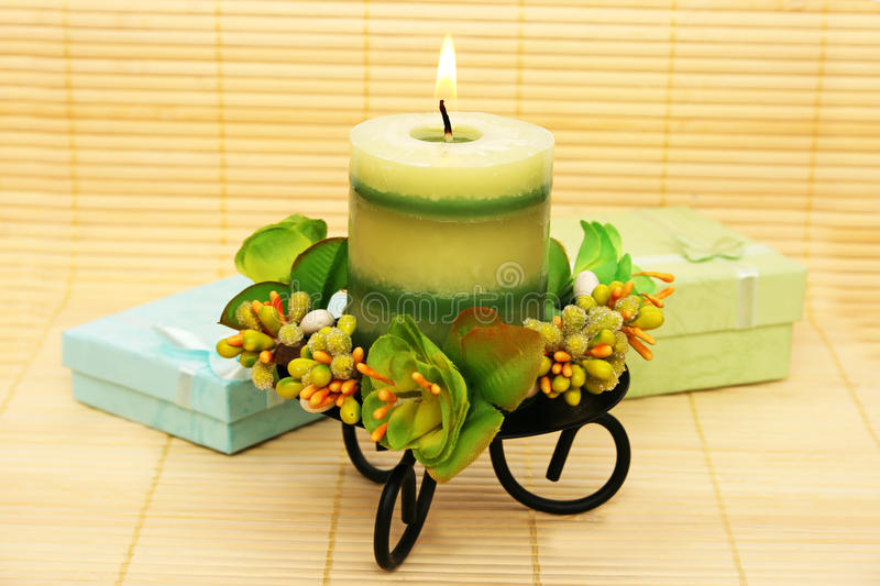 Candle and present boxes stock photo