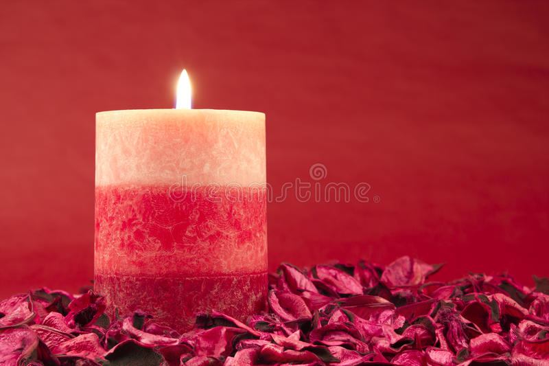 Download Candle On Red Background Stock Photo - Image: 28933880