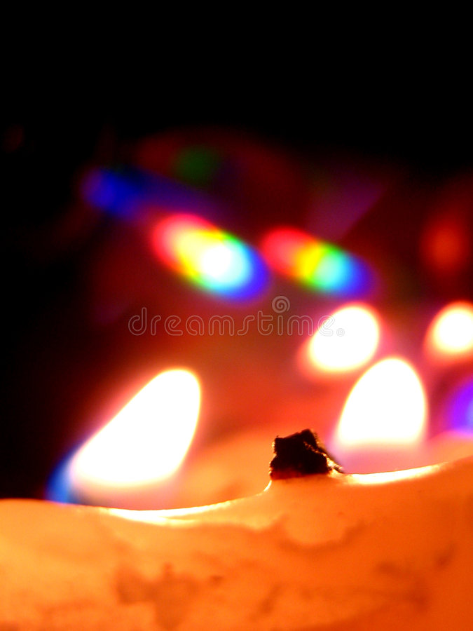 Candle Reflections. A candle reflects beautifully on a CD royalty free stock photo