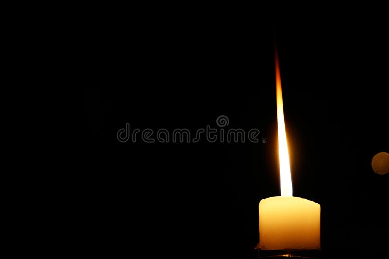 Candle shining in the dark royalty free stock photography
