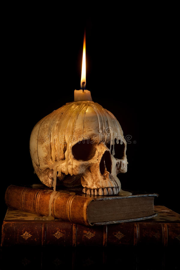 Candle on skull 1 royalty free stock photos