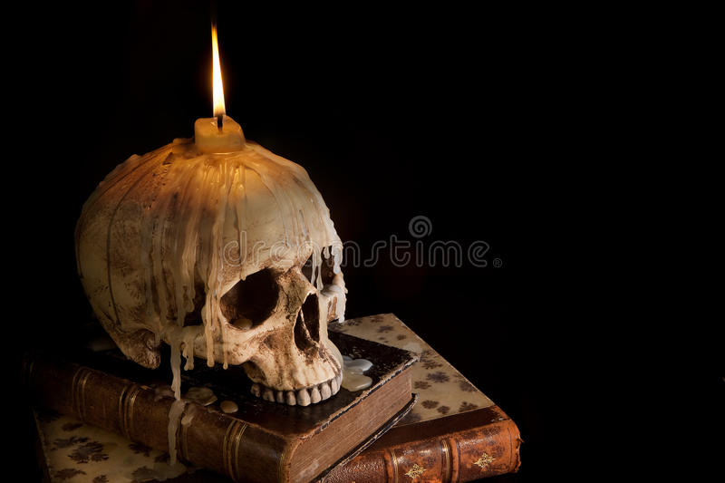 Candle on skull 4 stock photos