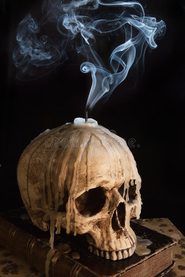 Candle on skull 7 royalty free stock photography