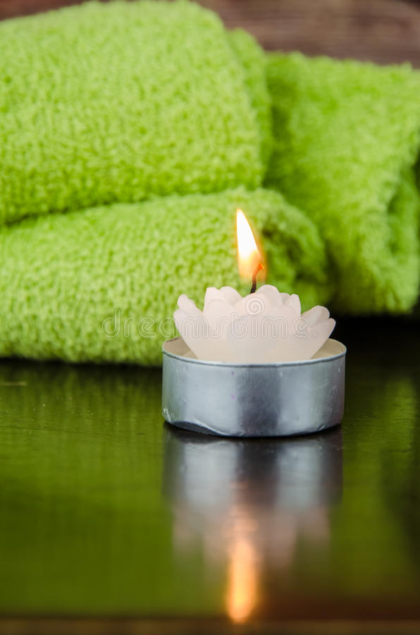 Candle still life. Green towel and candle still life concept royalty free stock photos