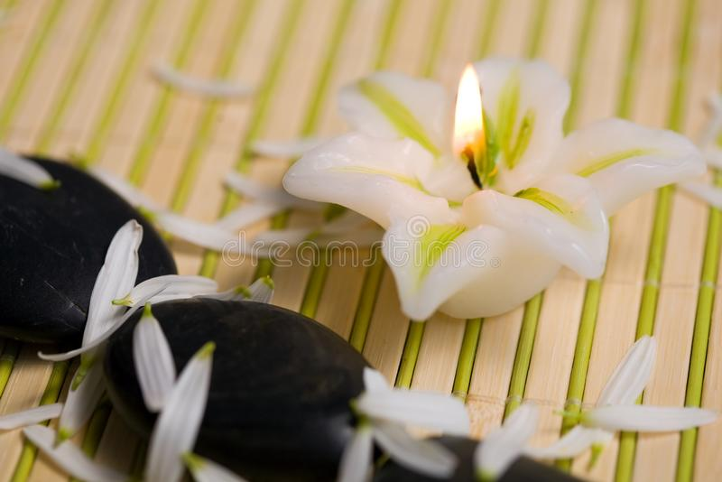 Candle and stones. An image of stones for spa massage and a candle stock photo