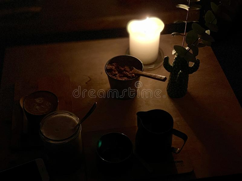 Candle on a table in a coffee shop stock images