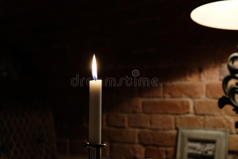 Candle on the table, romantic dinner stock image