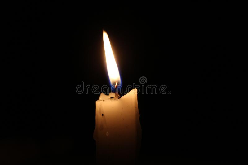 Candle. Thousands of candles can be lighted from a single candle, and the life of the candle will not be shortened. Happiness never decreases by being shared stock images