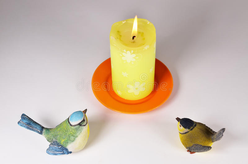 The candle and two birds II stock photo