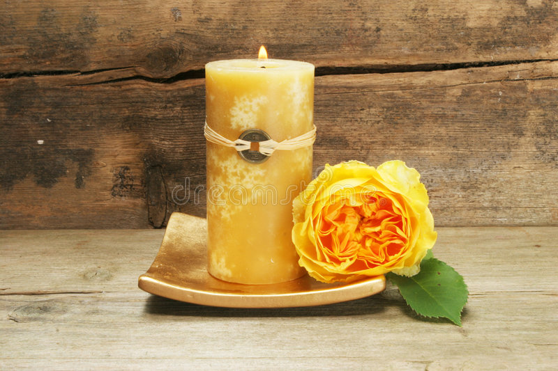 Candle and yellow rose royalty free stock photos