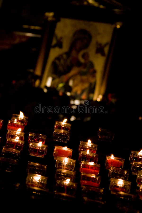 A candle for you. A set of cristian candle offered to our Madonna royalty free stock photos