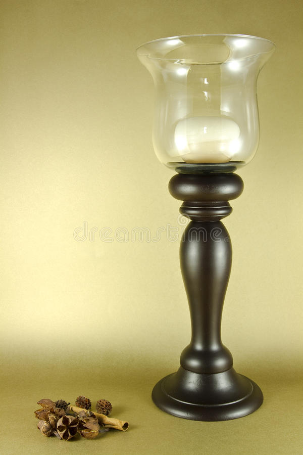 Candleholder. Wooden candleholder with golden background stock photography