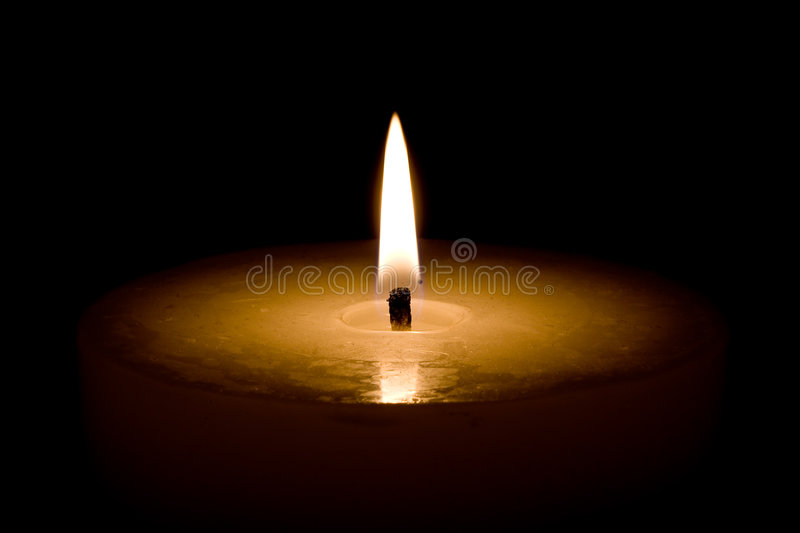 Candlelight. Photo of candle in Chrismastime royalty free stock photography