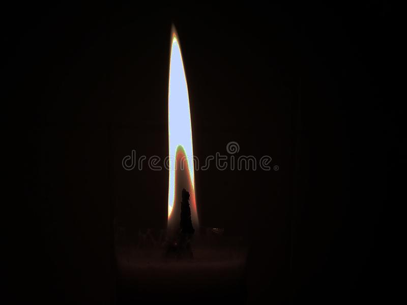 Candlelight in a dark place stock photo