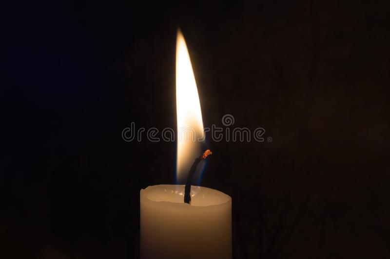 A single candle burning stock photos