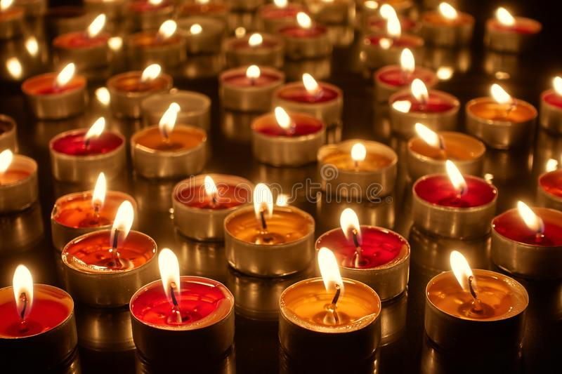 Many burning candles royalty free stock images
