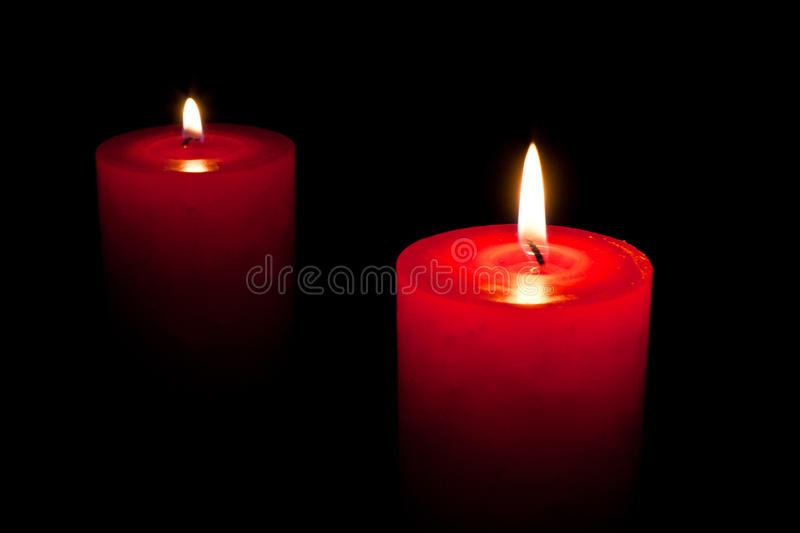 Candles. Two candles in black night with flame stock image