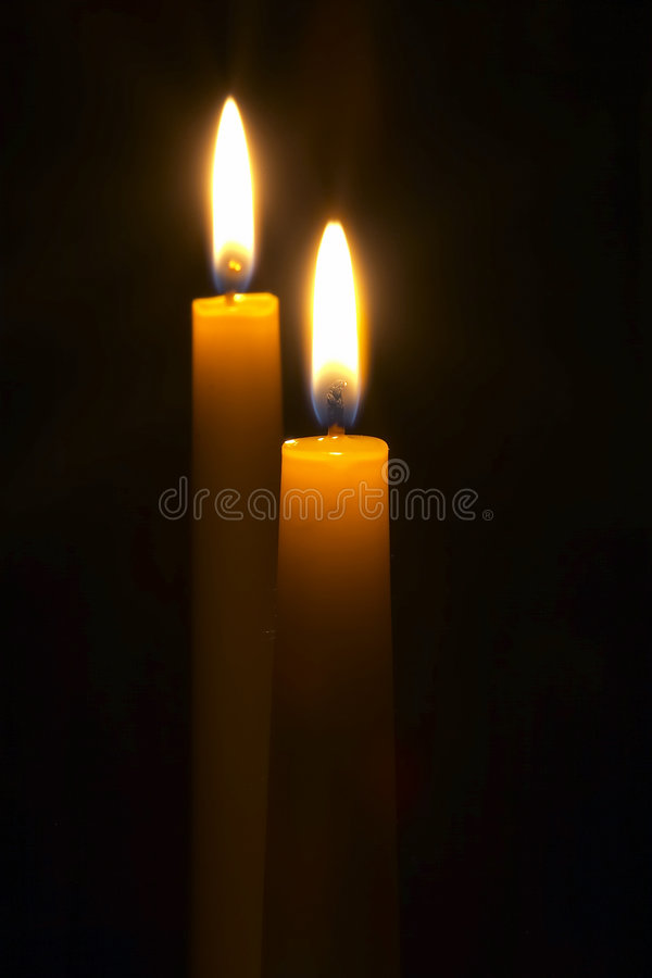 Candles. 2 Candles on black stock photos