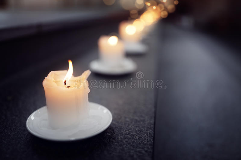 Candles on alter steps in a church stock images