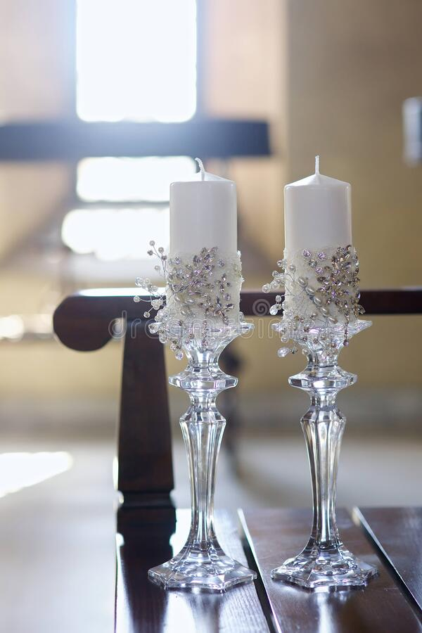 Candles as a decoration for the wedding of a couple. Of newlyweds stock photo