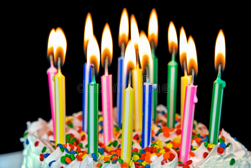 Candles on a birthday cake. Many candles on a birthday cake stock image