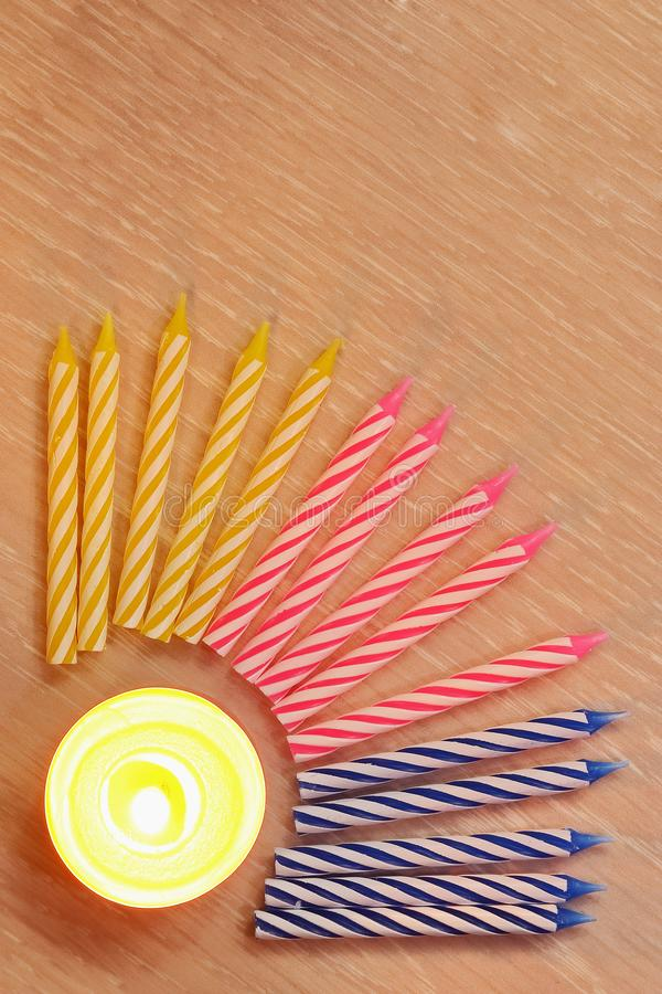 Candles for birthday cake, curled multicolored spiral stock photo