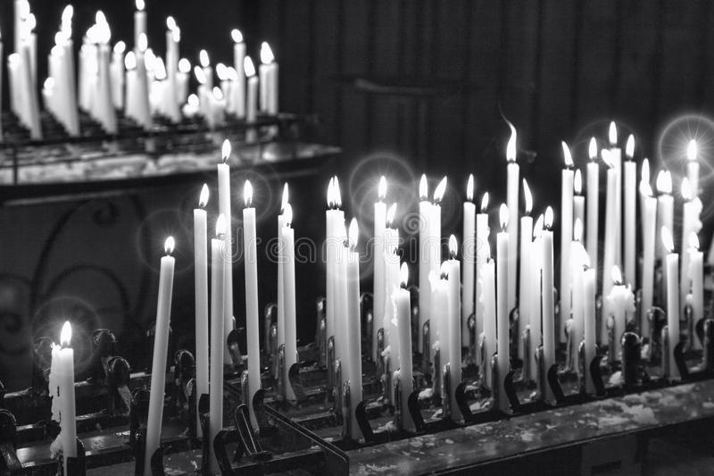 Candles. Black and white photo. Some votive candles, in a Italian church during Xmas time royalty free stock images