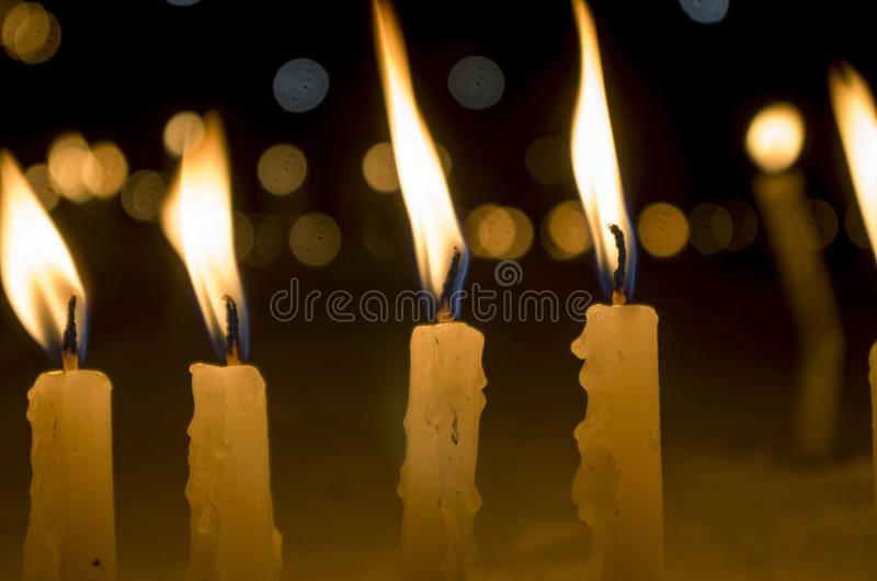 Candles and bokeh. Apart for just light, candles are used for a variety of purposes all over the world. From birthdays to death ceremonies, candles are used in a stock photography
