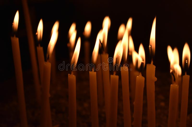 Candles Burning in a church stock image