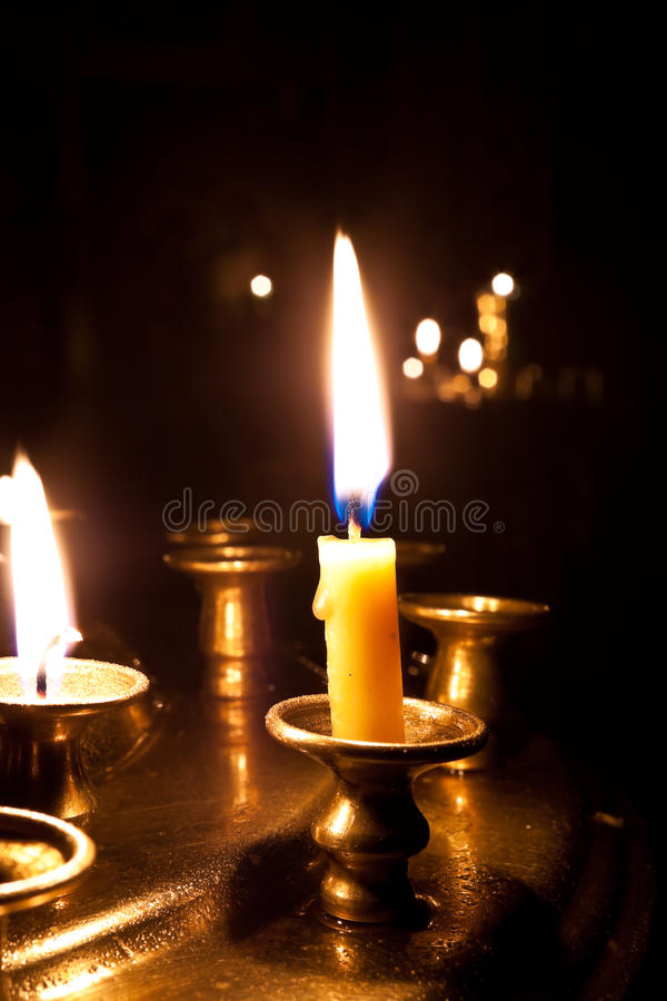 Candles burning in the church. stock image