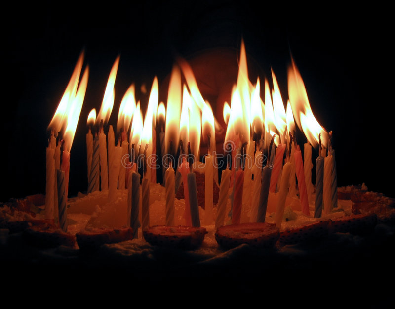 The candles on a cake stock images